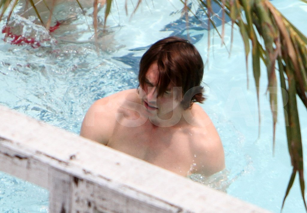 Tom Cruise takes a shirtless swim on his birthday.