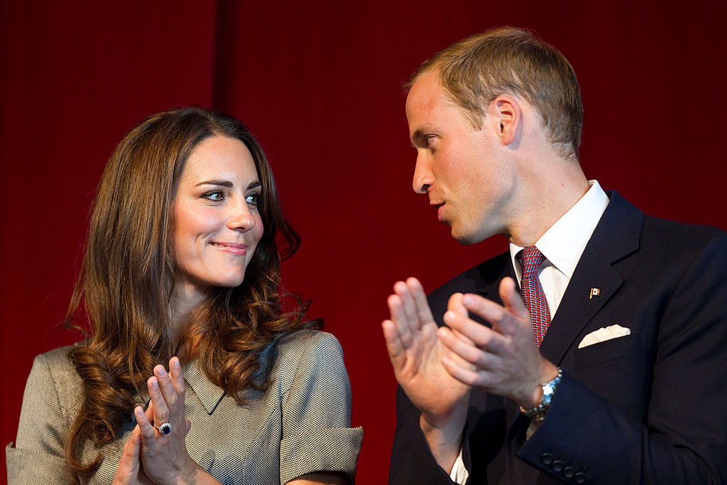 Prince William and Kate Middleton clap as they exchange glances.
