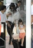 Katie Holmes and Suri Cruise sported matching umbrellas.