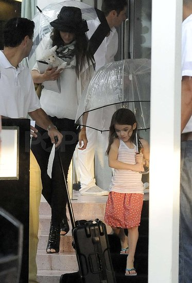 Katie Holmes and Suri Cruise braved the rain.