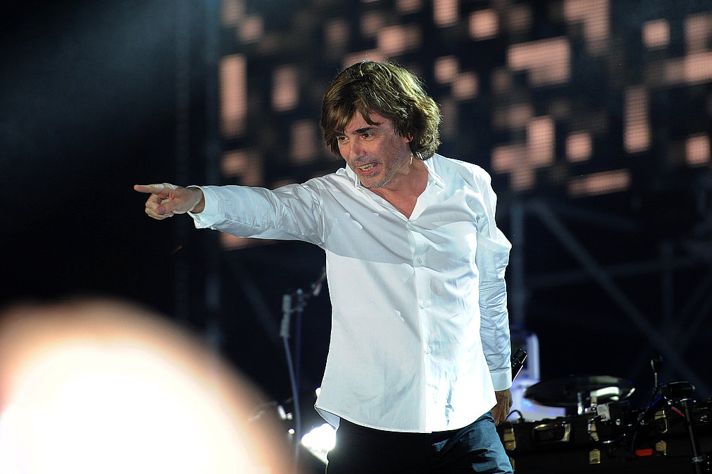 French electropop artist Jean Michel Jarre points at the crowd at his sound and music show for Princess Charlene of Monaco and Prince Albert II of Monaco.