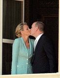 The newly married couple Princess Charlene of Monaco and Prince Albert II of Monaco kiss.