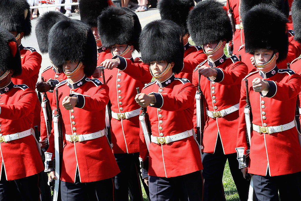 Soldiers in bearskins march during Canada Day celebrations.