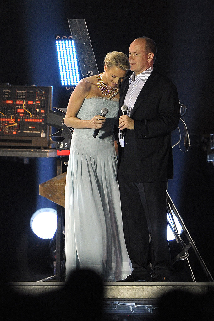 Princess Charlene of Monaco and Prince Albert II of Monaco share a sweet moment at the Jean Michel Jarre concert.