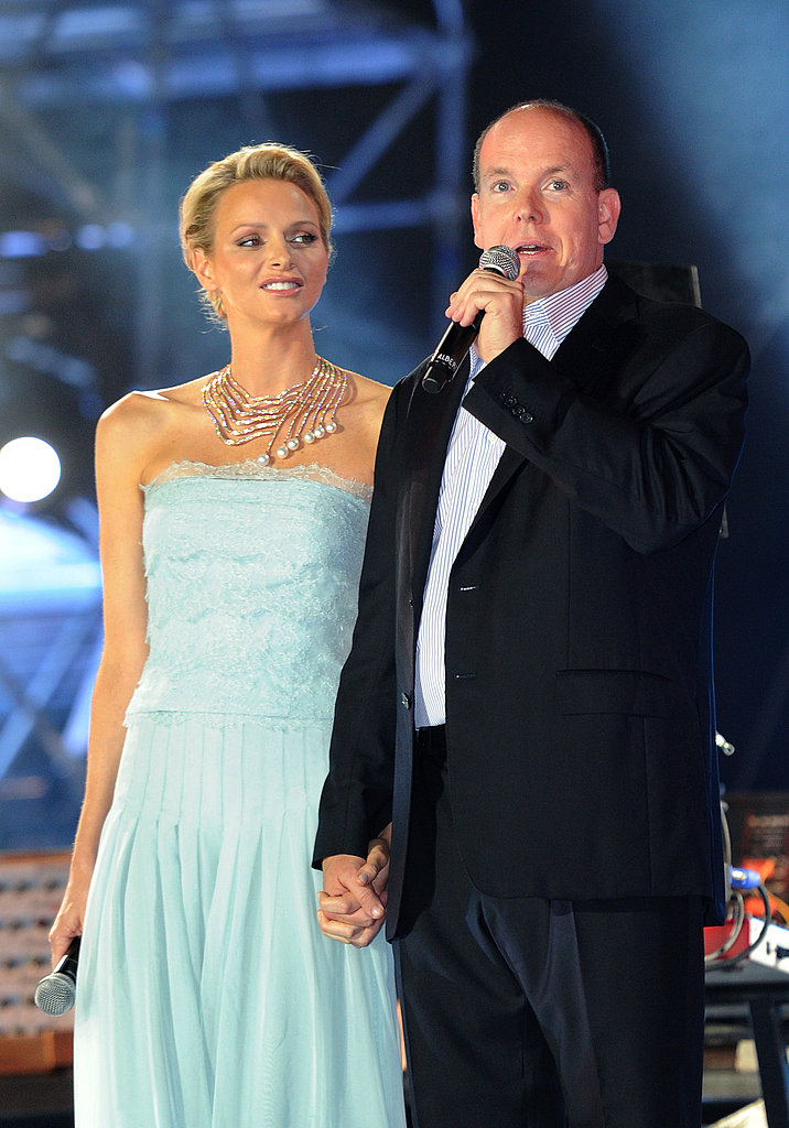 Prince Albert II of Monaco and his wife Princess Charlene address the crowds at the concert.