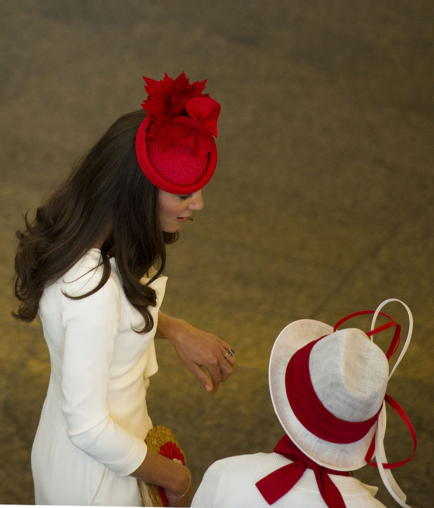 Kate wore a red fascinator from Lock and Co.