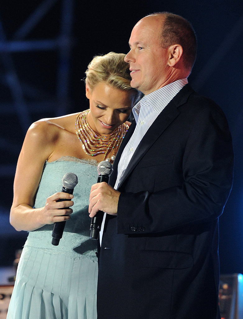 Princess Charlene of Monaco leans on the shoulder of her husband Prince Albert II of Monaco at the concert.
