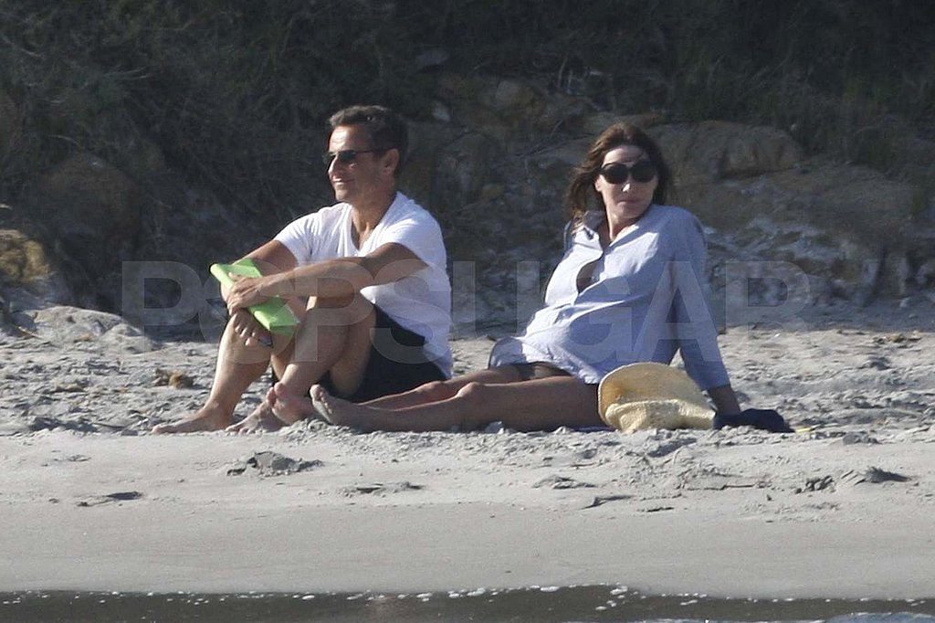 Carla Bruni Bares Her Pregnant Belly in a Bikini on the Beach With Nicolas Sarkozy
