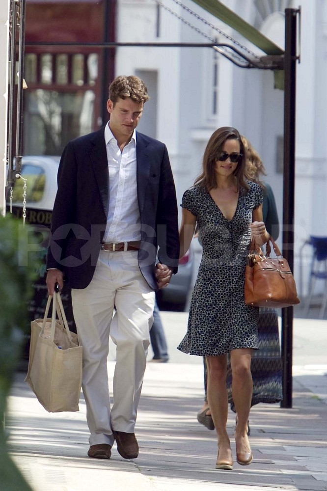 Pippa Middleton and Alex Loudon holding hands in London.