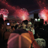 Partygoers watch the fireworks over New York City.