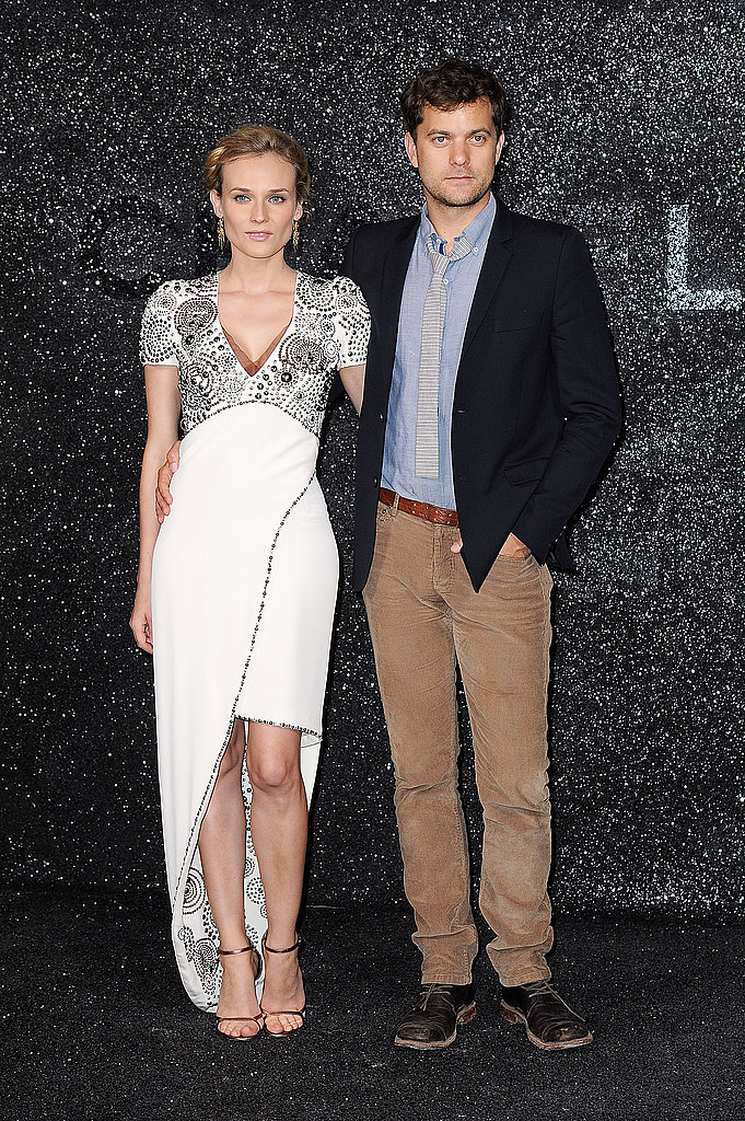 Diane Kruger and Joshua Jackson pose at the Chanel show in Paris.