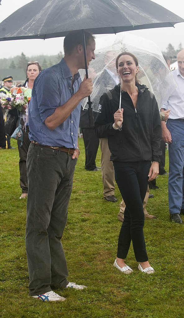 Kate Middleton and Prince William smiled despite the rain.