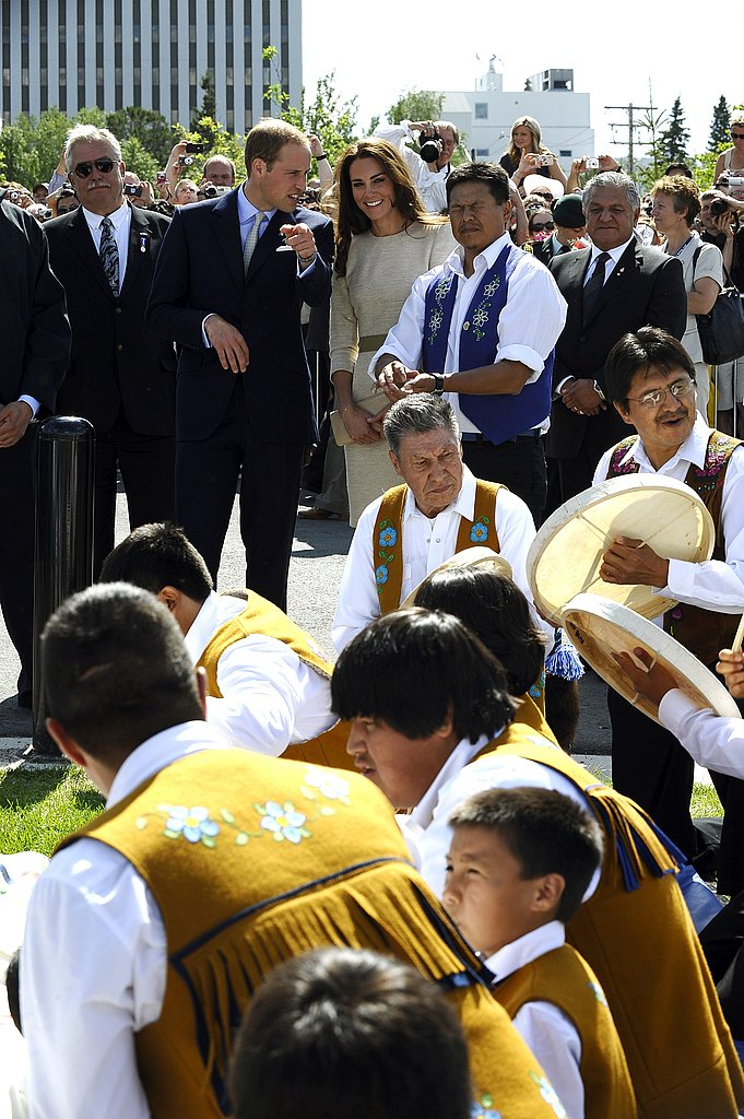 Prince William and Kate Middleton watch a drum ceremony.