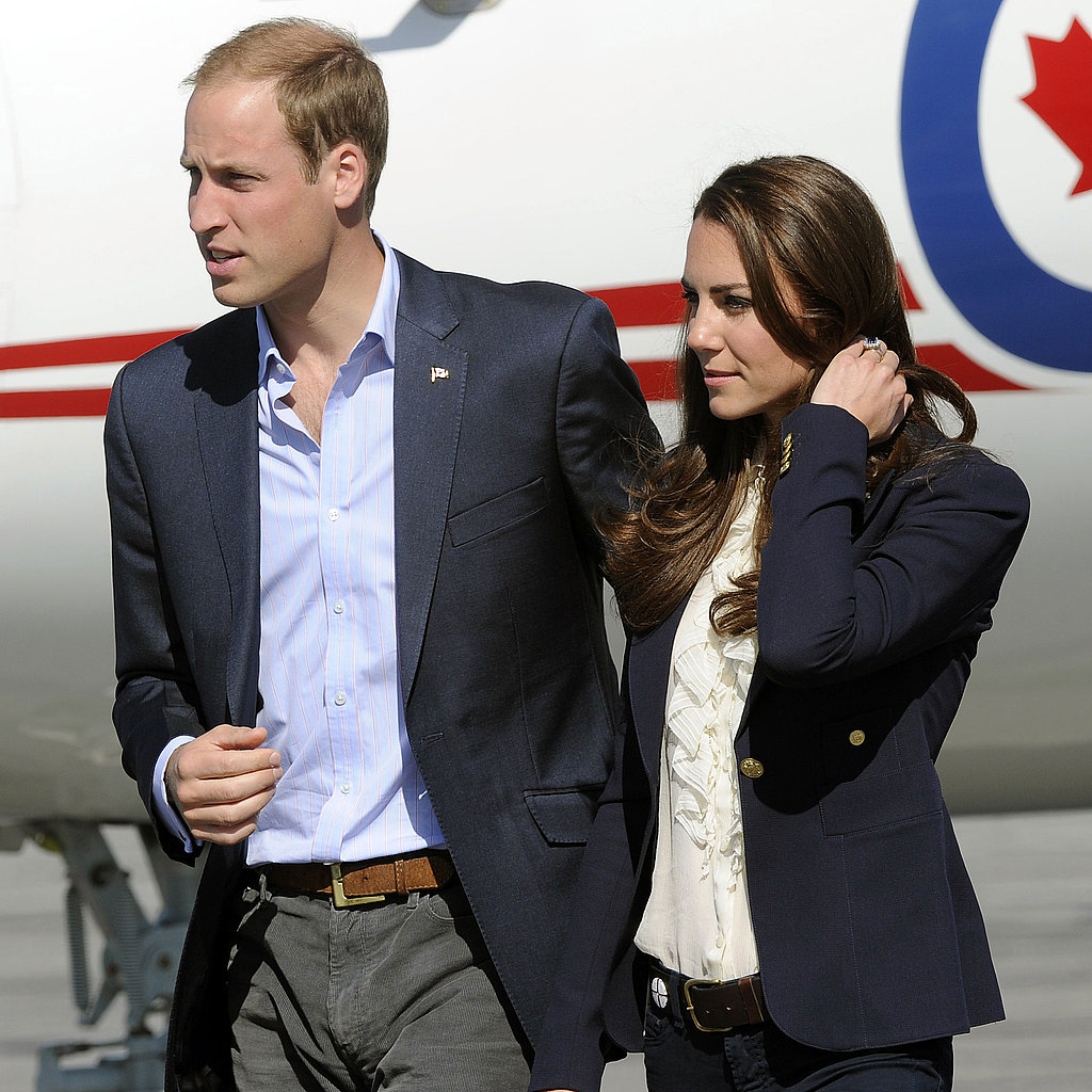 Kate Middleton and Prince William in blue blazers.
