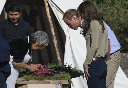 Prince William and Kate Middleton watched their food being prepared.