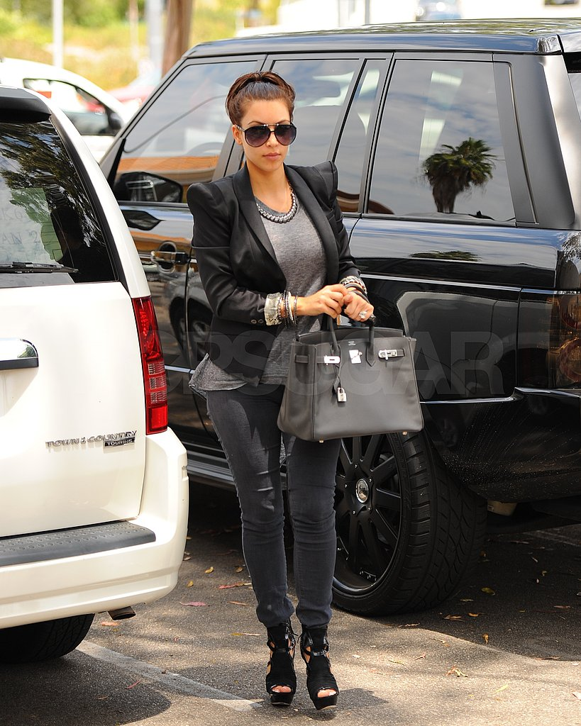 Kim Kardashian wore aviator shades in LA today.
