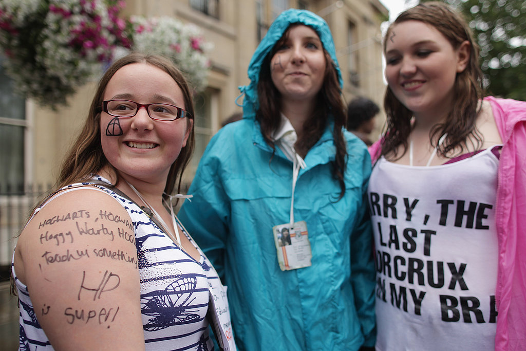 Three fans brave the rain to attend the Harry Potter and the Deathly Hallows Part 2 premiere.