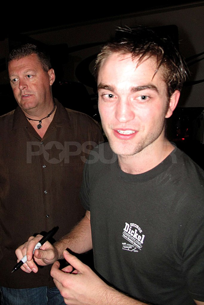 Robert Pattinson greeted fans on the set of Cosmopolis.