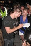 Robert Pattinson signed autographs for fans.