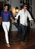 Tom Cruise and Katie Holmes hold hands in Miami.