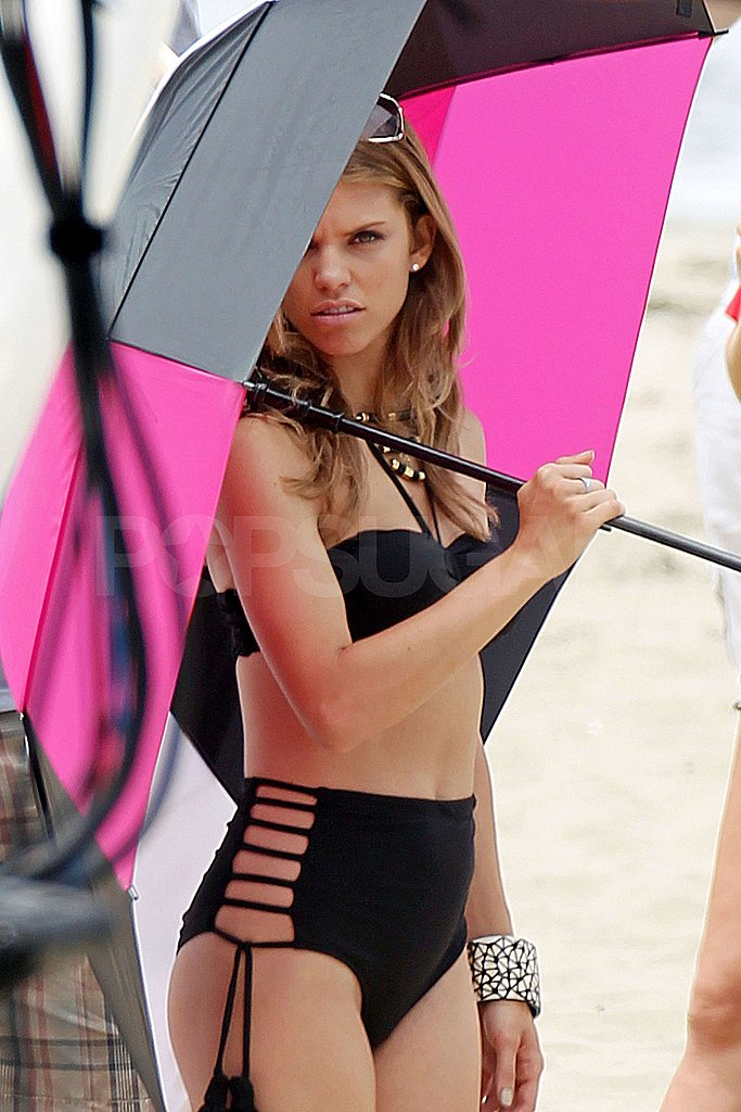 AnnaLynne McCord used an umbrella to shield her bikini body from the sun.