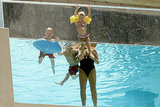Maddie Aldridge hung on to the side of the pool with Lynne Spears, Sean Preston Federline, and Jayden James Federline.
