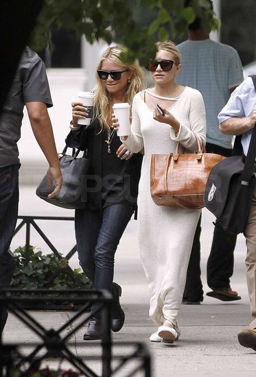 Ashley Olsen and Mary-Kate Olsen carried coffee cups.