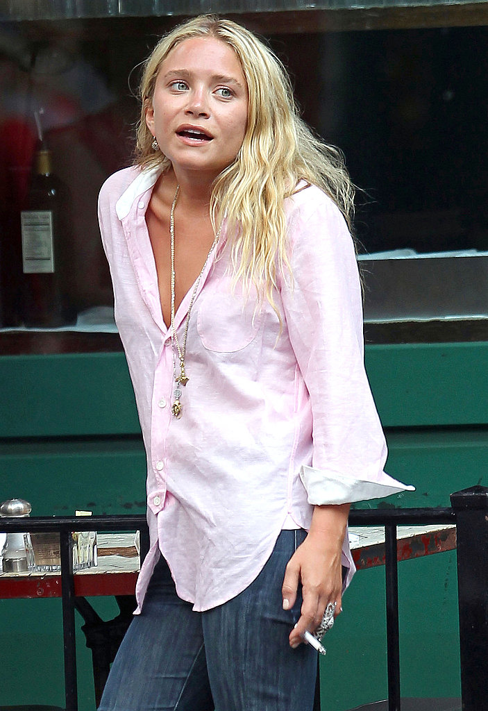 Mary-Kate Olsen in a buttoned-down shirt.