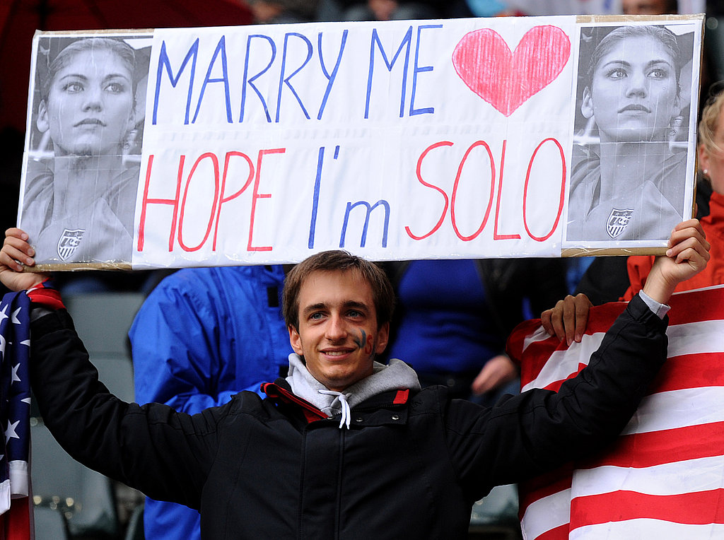 "A USA fan holds a placard reading ""Marry me, Hope, I'm Solo."""