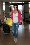 Kim Kardashian with a yellow Hermes bag.