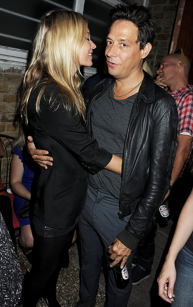 Kate Moss and Jamie Hince kiss.