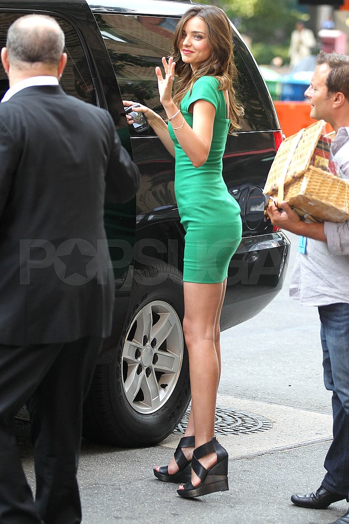 Miranda Kerr waves in NYC.
