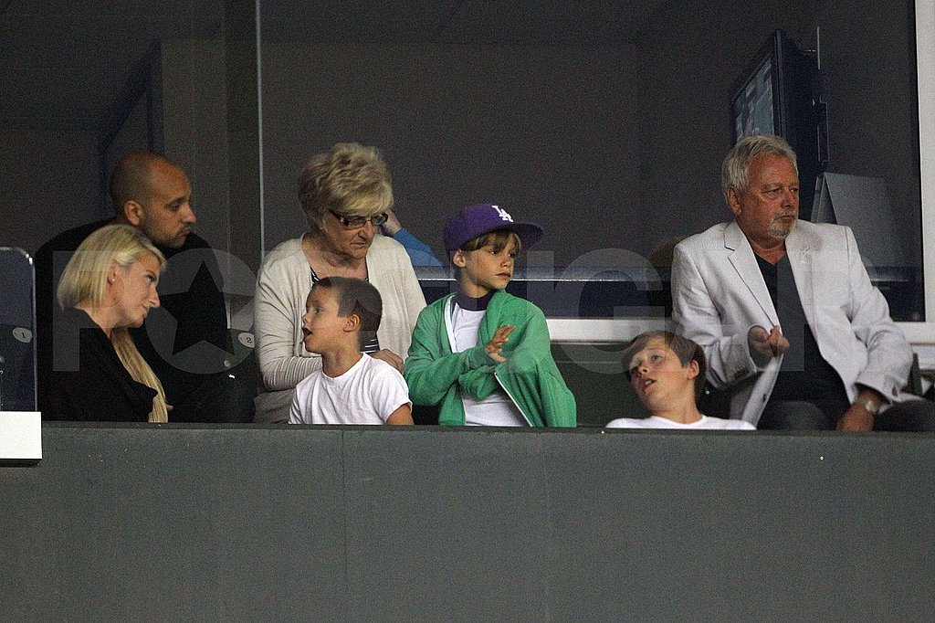 Romeo, Cruz, and Brooklyn Beckham watch their dad David play.