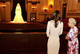 Kate Middleton and Queen Elizabeth view Kate's Alexander McQueen gown.