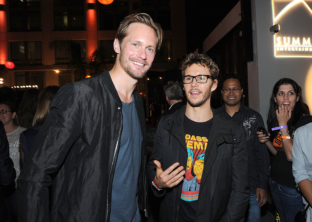 Alexander Skarsgard flashed a smile with Ryan Kwanten.