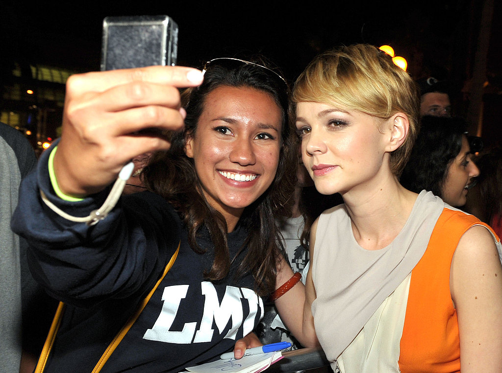 Carey Mulligan snapped a picture with a fan.
