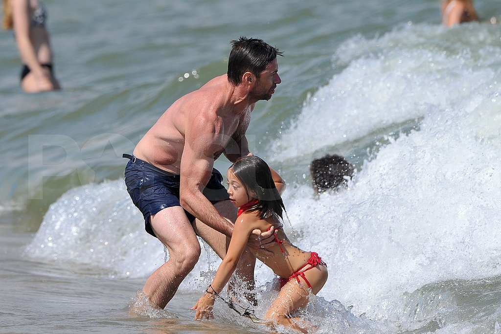 Hugh Jackman shirtless on the beach.