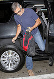 George Clooney with his luggage.