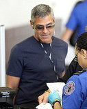 George Clooney at LAX with headphones in.