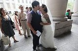 Lailah and Rachel Pepe kiss while waiting on line to get married at the Brooklyn city clerk office.