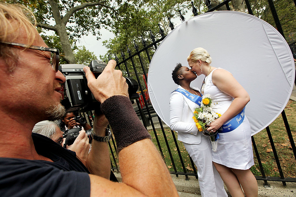 Da'onna Johnson and Amanda Johnson from Pennsylvania kiss after marrying in Manhattan.