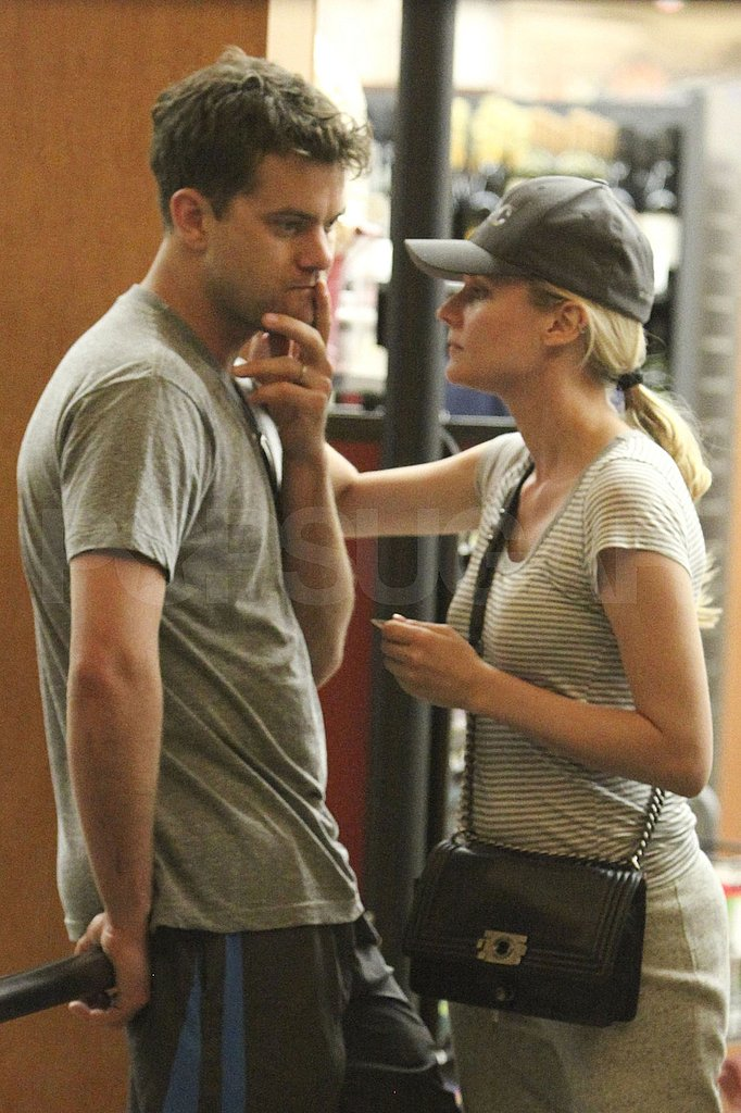 Diane Kruger and Joshua Jackson about to hug in LA.