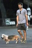Joshua Jackson walks his basset hound.