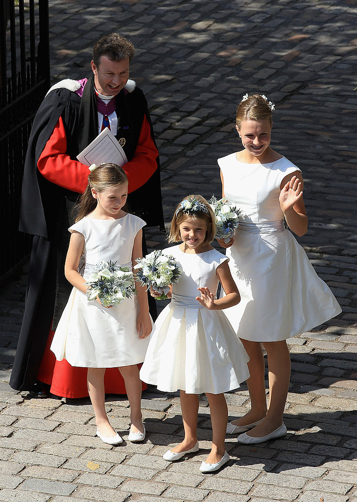 The little bridesmaids join Reverend Neil Gardner.