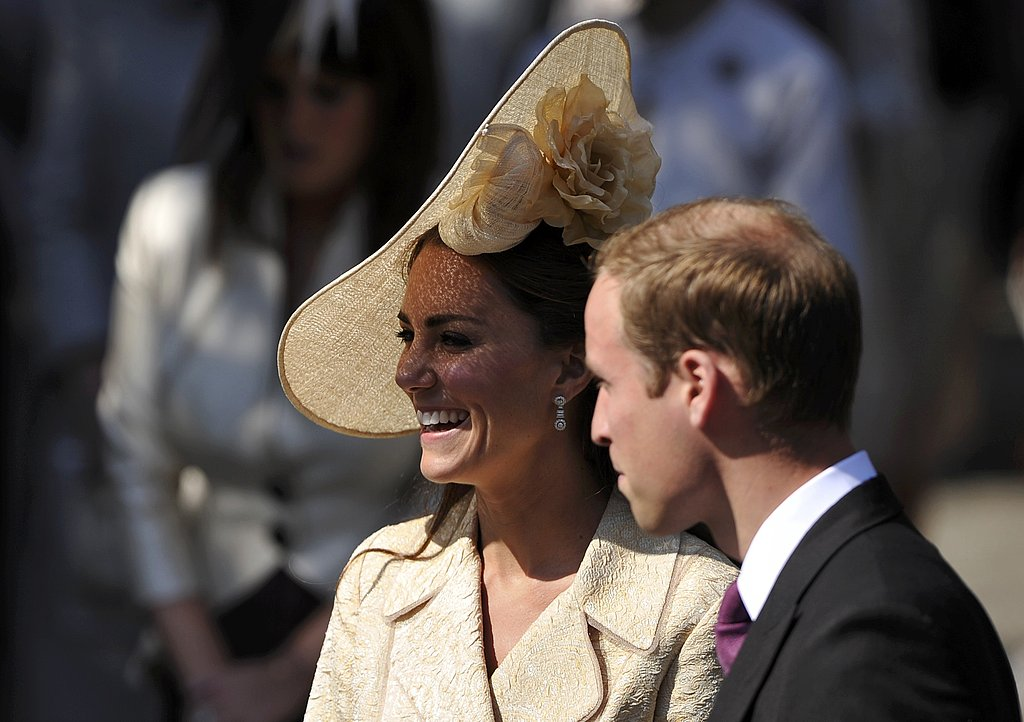 Kate laughs with husband Will.