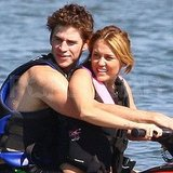 Miley Cyrus and Liam Hemsworth on a jet ski.