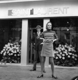 Spotted standing outside his Rive Gauche boutique in France, with a model wearing a skirt and sweater from his ready-to-wear collection.
