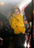 Beyoncé Knowles in yellow fur.