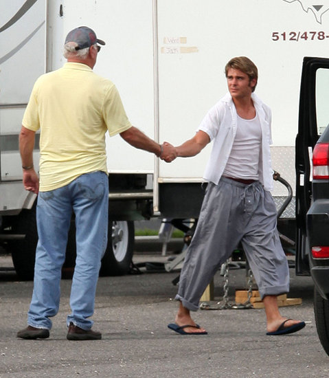 Zac greeted someone working on the set.