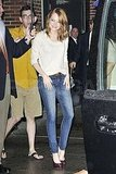 Emma arrived in jeans before slipping into her dress.